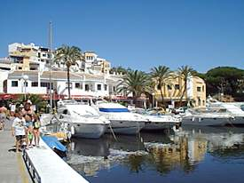 Restaurants and yachts at Cabopino marina and harbour